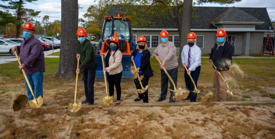 shot of golden shovels breaking ground