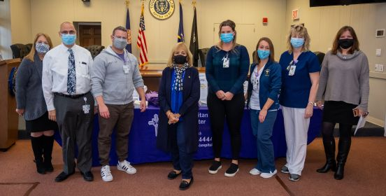 Supervisor, Town and Hospital Officials take group photo all wearing masks